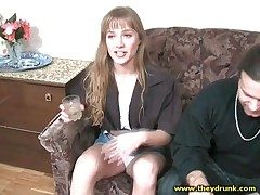 Cute drinker girl smokes sensually and smiles
