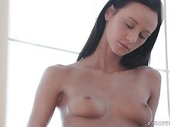 Brunette Eveline Neill rubs her sexy tiny tits