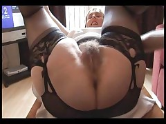 Hairy huge-chested mature gal in slip and girdle does upskirt and